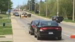 OPP have Broadway Street in Tillsonburg, Ont. blocked off on Tuesday, May 21, 2019 as they investigate a fatal crash involving a pedestrian. (Wayne Jennings / CTV London)