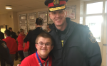 St. Thomas Police Chief Chris Herridge meets Special Olympian Julian, a member of the Arthur Voaden Secondary School gold-medal winning basketball team, on Tuesday, May 21, 2019.