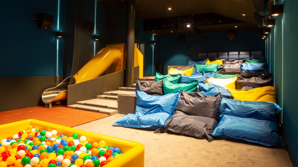 The cinema designed for children includes bean bag seats, a ball pit, and a slide. (Pathe Suisse SA)