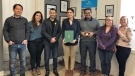 Marwan Tabbara presenting the Canada 150 Award of Excellence to d staff at GROSCHE International in Cambridge. (Courtesy: GROSCHE International)