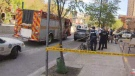Emergency crews attend the scene of a stabbing near Spadina and Washington avenues on May 21, 2019.