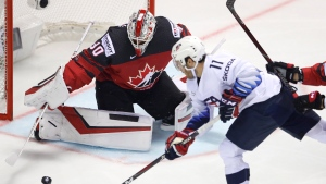 FILE - Canada's goaltender Matt Murray, left, makes a save against Luke Kunin of the U.S., right, during the Ice Hockey World Championships group A match between Canada and the United States at the Steel Arena in Kosice, Slovakia, Tuesday, May 21, 2019. (AP Photo/Petr David Josek)