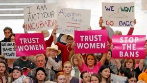 Activists gather in the Utah State Capitol Rotunda to protest abortion bans happening in Utah and around the country Tuesday, May 21, 2019, in Salt Lake City. State law makers recently passed a ban on abortions after 18 weeks, but have agreed not to enforce the ban as a court challenge plays out. (AP Photo/Rick Bowmer)