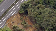 The shoulder of an express way is caved in after a magnitude 6.6 earthquake hit the area in Makinohara, west of Tokyo Tuesday, Aug. 11, 2009. (AP / Kyodo News)