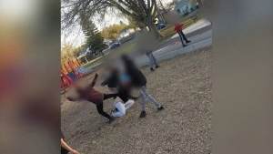 A screenshot from a video that appears to show an assault on a woman by several children at Pleasant Hill Park.