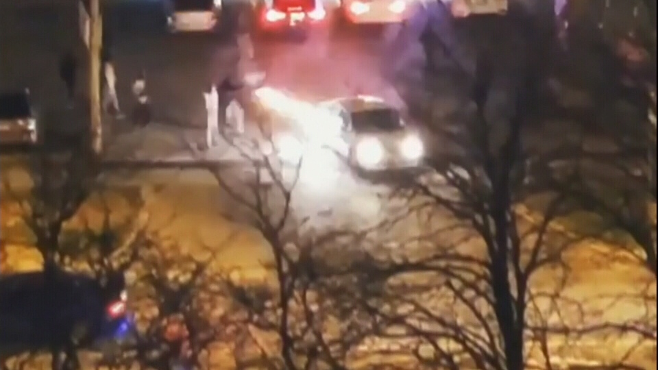 Video posted to social media shows fireworks being shot into a moving car in Toronto on Victoria Day. (CTV Toronto)