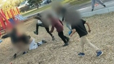 Video appears to show children beating woman at Sa