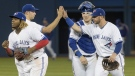 Toronto Blue Jays players celebrate defeating the Boston Red Sox in their American League MLB baseball game in Toronto Tuesday May 21, 2019. THE CANADIAN PRESS/Fred Thornhill