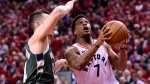 Toronto Raptors guard Kyle Lowry (7) drives for the basket as Milwaukee Bucks guard Pat Connaughton (24) defends during second half action in Game 4 of the NBA Eastern Conference final in Toronto on Tuesday, May 21, 2019. (THE CANADIAN PRESS / Frank Gunn)