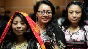 Guna indigenous women pose for a photo wearing traditional dresses decorated with Molas, after a press conference where Guna leaders demanded that the sports shoe company Nike remove their traditional Mola handcraft print from a shoe design, in Panama City, Tuesday, May 21, 2019. (AP Photo/Arnulfo Franco)