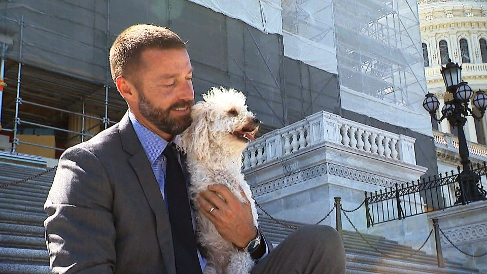 Pawsitive Change program creator Zack Skow is pictured on Capitol Hill with his rescue dog Cora Rose.