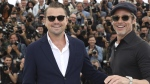 Leonardo DiCaprio, left, and Brad Pitt pose for photographers at the photo call for the film 'Once Upon a Time in Hollywood' at the 72nd international film festival, Cannes, on May 22, 2019. (Vianney Le Caer / Invision / AP)