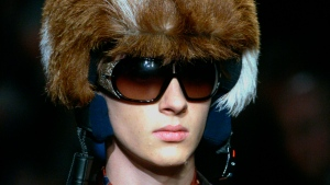 In this Monday, Jan. 16, 2006 file photo, a model shows off a furred helmet, during the Prada Fall/Winter 2006/2007 men's fashion collection, presented in Milan, Italy. The Prada Group has become the latest luxury fashion house to go fur-free. (AP Photo/Luca Bruno, File)
