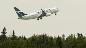 A WestJet flight departs Halifax Stanfield International Airport in Enfield, N.S., on Thursday, July 2, 2015. (Andrew Vaughan / THE CANADIAN PRESS)