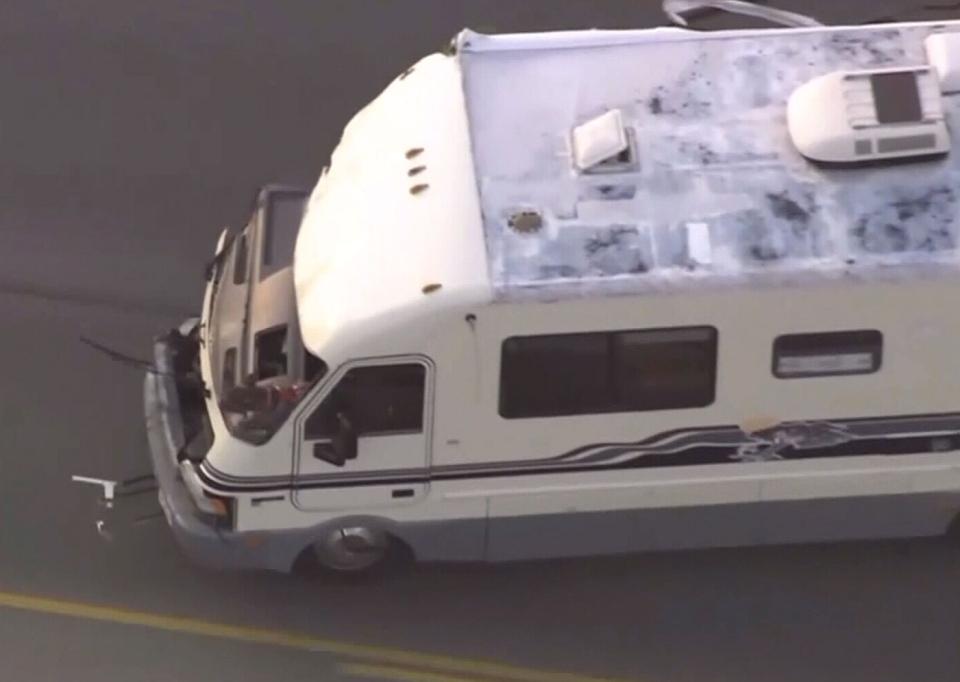 A dog sticks its head out of the front of a damaged RV during a wild police chase in Los Angeles.