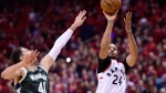 Milwaukee Bucks forward Nikola Mirotic (41) reaches for the ball but can't stop Toronto Raptors forward Norman Powell's three point basket during second half action in Game 4 of the NBA Eastern Conference final in Toronto on Tuesday, May 21, 2019. THE CANADIAN PRESS/Frank Gunn