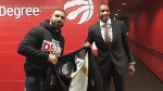 Raptors president Masai Ujiri presents Drake with the pricey new coat. (Raptors/Twitter)
