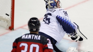 Canada's Anthony Mantha, left, witches as goaltender Cory Schneider of the US, right, fails to make a save during the Ice Hockey World Championships group A match between Canada and the United States at the Steel Arena in Kosice, Slovakia, Tuesday, May 21, 2019. (AP Photo/Petr David Josek)