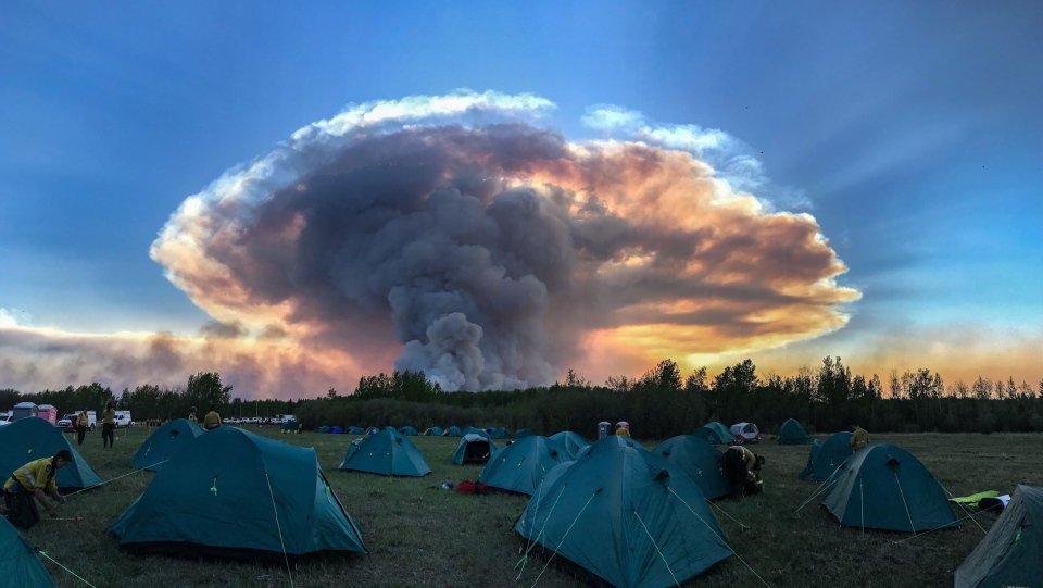 Smoke from a prescribed burn near the High Level fire over a firefighter camp. (CREDIT: ZACH LUBBERS)