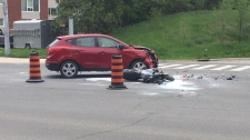 A car and a motorcycle after a crash