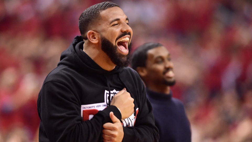 d01b2d123d9 Drake smiles as he watches the Toronto Raptors take on the Milwaukee Bucks  during first half action in Game 4 of the NBA Eastern Conference final in  Toronto ...