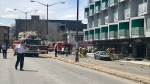 A car slammed into a building in Quebec City, causing a dozen injuries and sparking a fire.