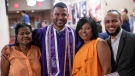 Frank Baez, second from left, is pictured with his grandmother, mother and brother at his graduation from New York University's Rory Meyers College of Nursing. (Photo courtesy of Kate Lord/ New York University)
