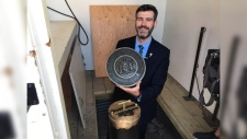 Mayor Don Iveson unveils a time capsule buried in 1967 for the dedication of Fort Edmonton Park. (JOHN HANSON/CTV EDMONTON)