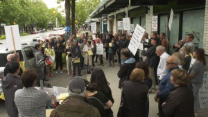 Dozen's protest outside of MLA David Eby's office on Tuesday, May 21, 2019.
