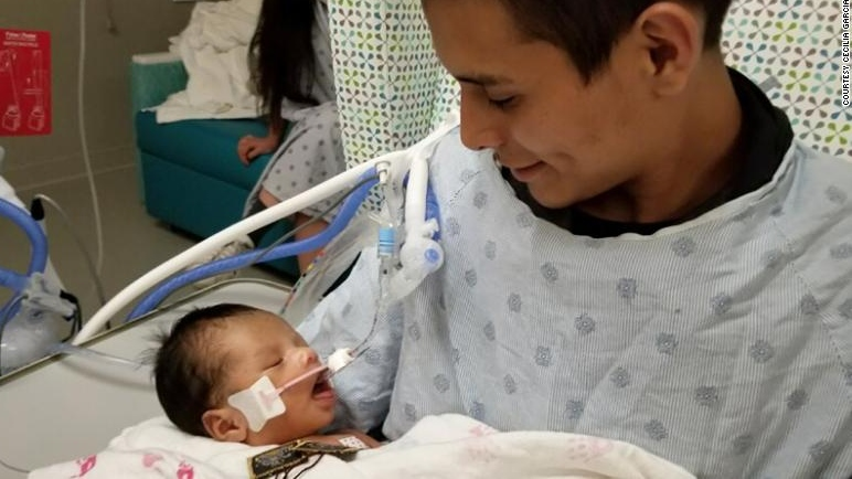 Baby cut from dead mother opens his eyes for first time