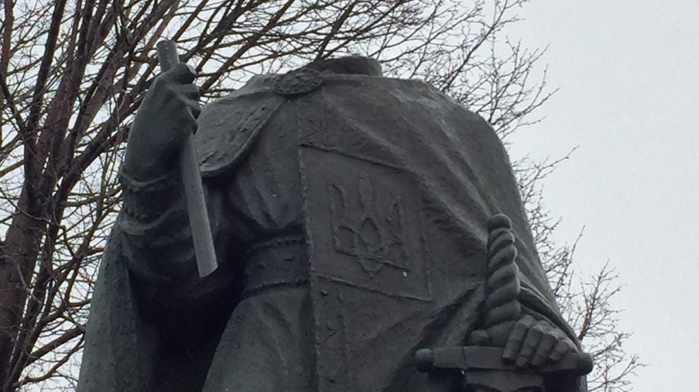 Statue outside Winnipeg church beheaded