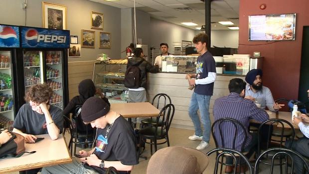 Customers enjoying lunch at Shami's Bakery.