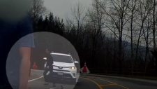 Coquitlam RCMP are looking for the man circled in the dash cam footage from a fatal crash on March 25, 2019. (Coquitlam RCMP)