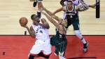 Toronto Raptors centre Serge Ibaka (9) goes the net as Milwaukee Bucks forward Giannis Antetokounmpo (34) defends during first half NBA Eastern Conference finals basketball action in Toronto on Sunday, May 19, 2019. THE CANADIAN PRESS/Frank Gunn