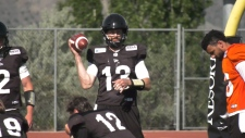 Quarterback Mike Reilly with his teammates in Kamloops for the team's training camp.