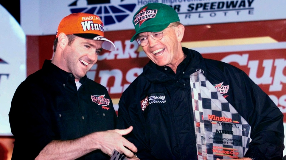 FILE - In this Wednesday, Oct. 6, 1999 file photo, Bobby Labonte, left, of Corpus Christi, Texas celebrates in victory lane with team owner Joe Gibbs after winning the pole position for Sunday's UAW-GM 500 race at the Lowe's Motor Speedway in Concord, N.C. (AP Photo/Chuck Burton, File)