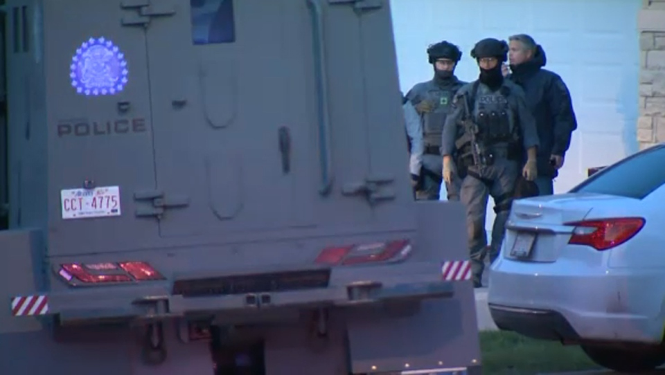CPS members outside of a Panorama Hills during the standoff that began Wednesday afternoon