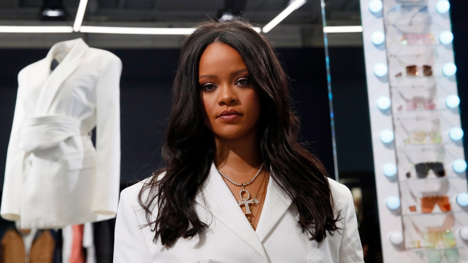 Singer Rihanna, the first black woman in history to head up a major Parisian luxury house, poses as she unveiled her first fashion designs for Fenty at a pop-up store in Paris, France, Wednesday, May 22, 2019. (AP Photo/Francois Mori)
