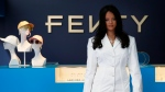 Rihanna poses as she unveils her first fashion designs for Fenty at a pop-up store in Paris, France, Wednesday, May 22, 2019. (AP Photo/Francois Mori)