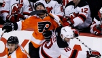 FILE - In this Jan. 8, 2011, file photo, Philadelphia Flyers' Daniel Carcillo, top, is hit in the face by a stick from New Jersey Devils' Rod Pelley during the third period of an NHL hockey game, in Philadelphia. (AP Photo/Matt Slocum, File)