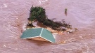 House swept away into river amid Oklahoma flooding