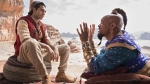 Mena Massoud as Aladdin, left, and Will Smith as Genie in Disney's live-action adaptation of the 1992 animated classic 'Aladdin.' (Daniel Smith / Disney via AP)
