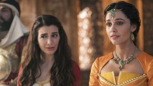 "Nasim Pedrad as Dalia, left, and Naomi Scott as Jasmine in Disney's live-action adaptation of the 1992 animated classic ""Aladdin."" (Daniel Smith/Disney via AP)"