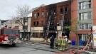 Firefighters survey the damage after a fire tore through a historic building in Toronto's Junction neighbourhood on May 23, 2019. (Peter Muscat/CTV News Toronto)