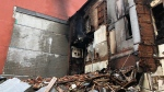 Charred walls and debris are visible at a historic building in The Junction after a fire on May 23, 2019. (Peter Muscat/CTV News Toronto)