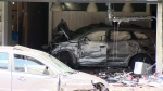 Car slams into building in Quebec City, sparking f