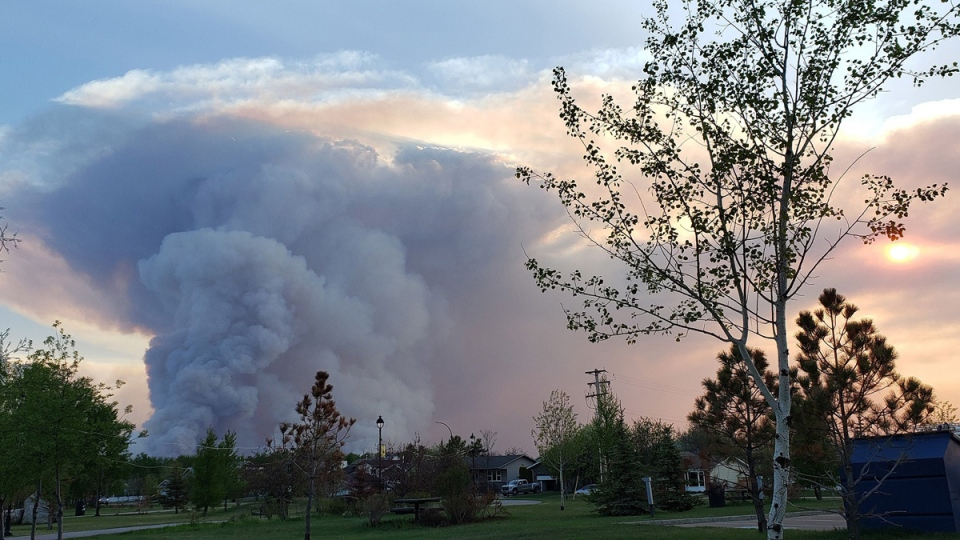 Smoke column rises from the Town of High Level, Alberta, on May 21, 2019. (THE CANADIAN PRESS / HO-Government of Alberta)