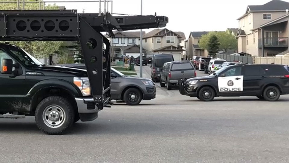 Police units blocked off a street in the Panorama Hills area on Thursday, May 23, 2019.