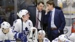 Toronto Maple Leafs' Mike Babcock, right, talks with assistant coach D. J. Smith, on Nov. 12, 2015. (THE CANADIAN PRESS / AP, Mark Humphrey)