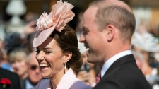 Prince William and Kate, Duchess of Cambridge attends the Royal Garden Party at Buckingham Palace in London, Tuesday May 21, 2019. (Dominic Lipinski/Pool via AP)
